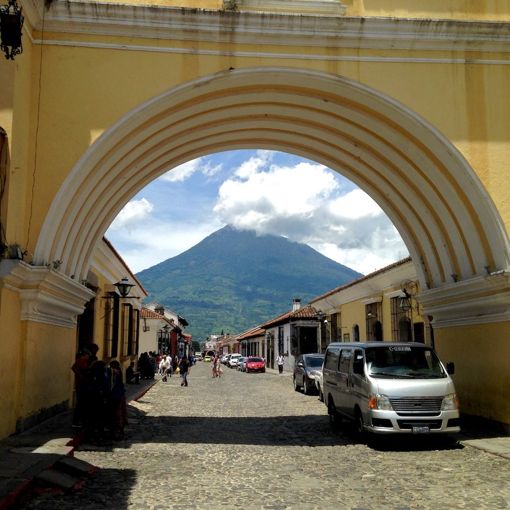 Cobblestone street in Antigua, with view of volcano